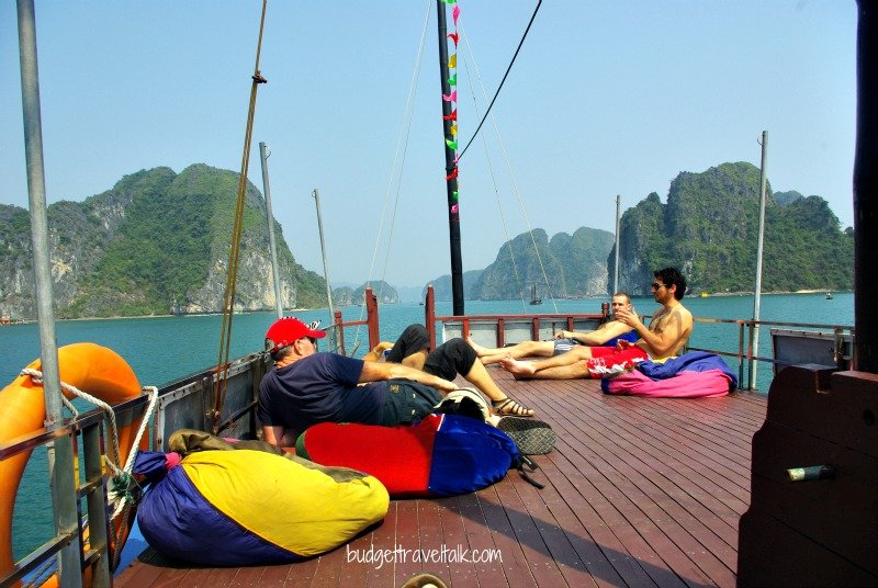 Relaxing in bean bags on top deck returning to Cat Ba island.