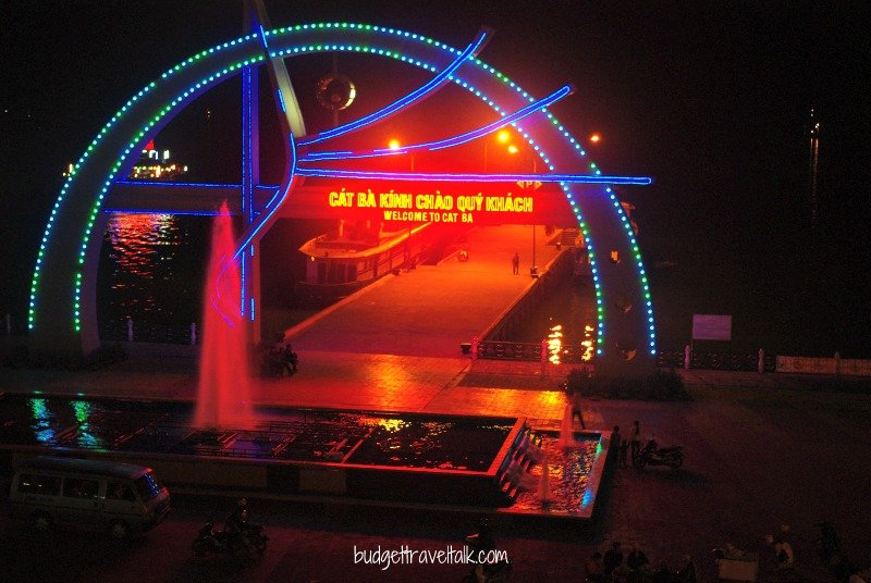 The welcome sign at the jetty on the esplanade. You can see the lights of a floating restaurant on the left.