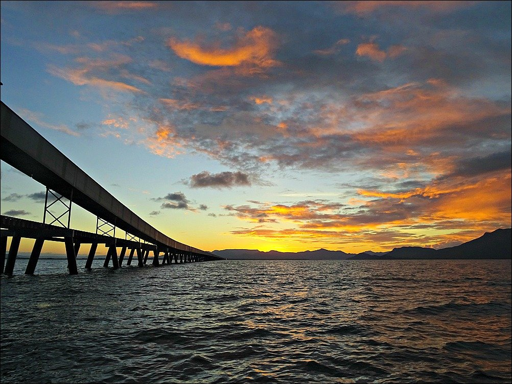5.76 km long Lucinda Jetty and Hinchinbrook Island in North Queensland Australia. Lucinda is a stepping off point for Hinchinbrook, Pelorus and Orpheus Islands.