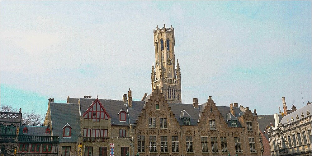 Beautiful old buildings and clock tower in Bruges Europe