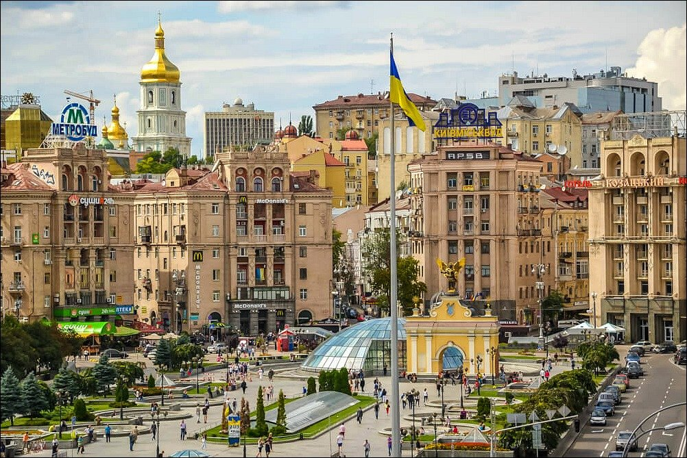 An city view of Kiev Ukraine with clay coloured multi-storey buildings and gold domes