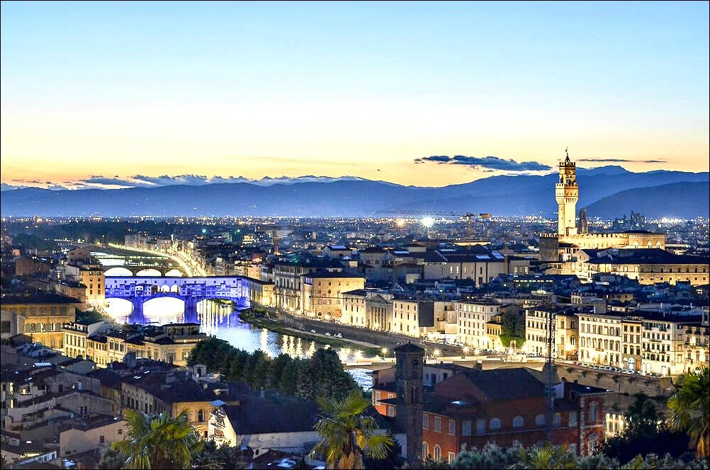 This photo of florence_piazzale michelangelo at dusk with the distant blue mountains and coloured bridge and river.